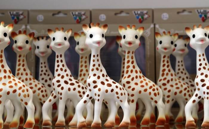 """Sophie The Giraffe poses in Teri Weiss' shop in Berly Hills, California on March 12, 2011. Sophie turns 50 years old. The teether became famous in Los Angeles when Teri Weiss, owner of the Bervely Hills boutique """"Elegant Child"""" put it in baby baskets she assembles for celebrity Parents.    AFP PHOTO / VALERIE MACON / AFP PHOTO / VALERIE MACON"""